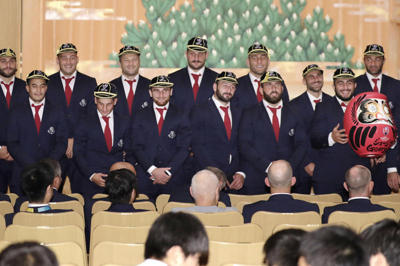 Georgia rugby team members pose for a photograph during a welcome ceremony in Nagoya, central Japan Wednesday, Sept. 18, 2019, ahead of the Rugby World Cup. (Kyodo News via AP)