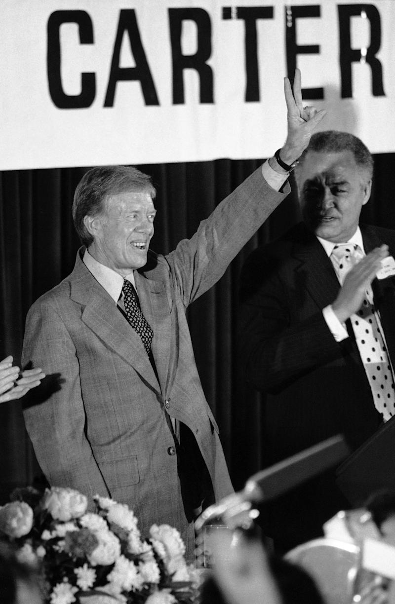 Jimmy Carter reacts to applause after his speech to the Democratic National Committee in Washington, May 26, 1979.