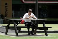 A man seen having his lunch at the Raffles Place Park on 7 April 2020, the first day of Singapore's month-long circuit breaker period. (PHOTO: Dhany Osman / Yahoo News Singapore)