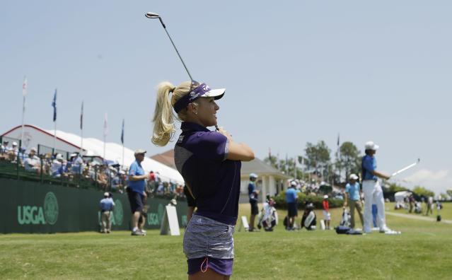 LPGA player Natalie Gulbis warms up on the driving range along side her male counter parts during the final round of the men's U.S. Open golf tournament in Pinehurst, N.C., Sunday, June 15, 2014. The women tee it up Thursday for the first round of the LPGA's U.S. Open golf tournament. (AP Photo/Chuck Burton)
