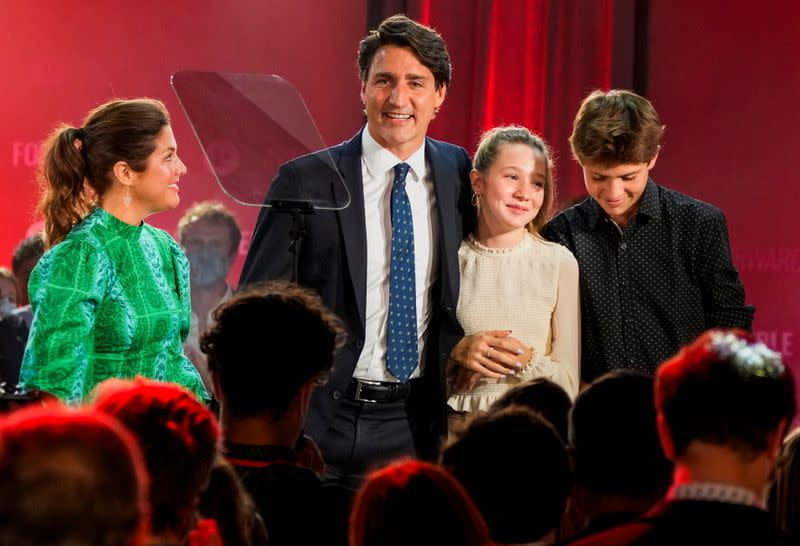 Canada's Liberal Prime Minister Justin Trudeau, accompanied by his wife Sophie Gregoire and their children Ella-Grace and Xavier, reacts during the Liberal election night party in Montreal
