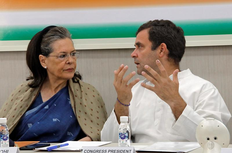 Rahul Gandhi, President of Congress party, speaks with his mother and leader of the party Sonia Gandhi during Congress Working Committee (CWC) meeting in New Delhi, India, May 25, 2019. REUTERS/Altaf Hussain