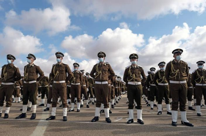 FILE PHOTO: Soldiers loyal to Libyan military commander Khalifa Haftar stand in formation during Independence Day celebrations in Benghazi