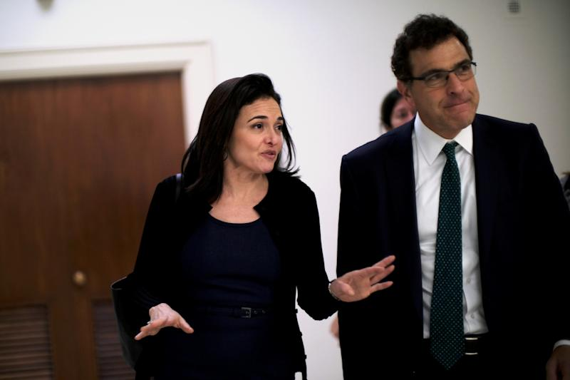 Sheryl Sandberg, Facebook's chief operating officer, and Elliot Schrage, its vice president of global communications and public policy, meet with lawmakers on Capitol Hill on Oct. 12. (JAMES LAWLER DUGGAN/Reuters)