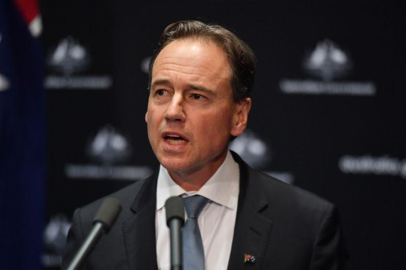 Pictured is Federal Health Minister Greg Hunt speaking to reporters during a press conference.