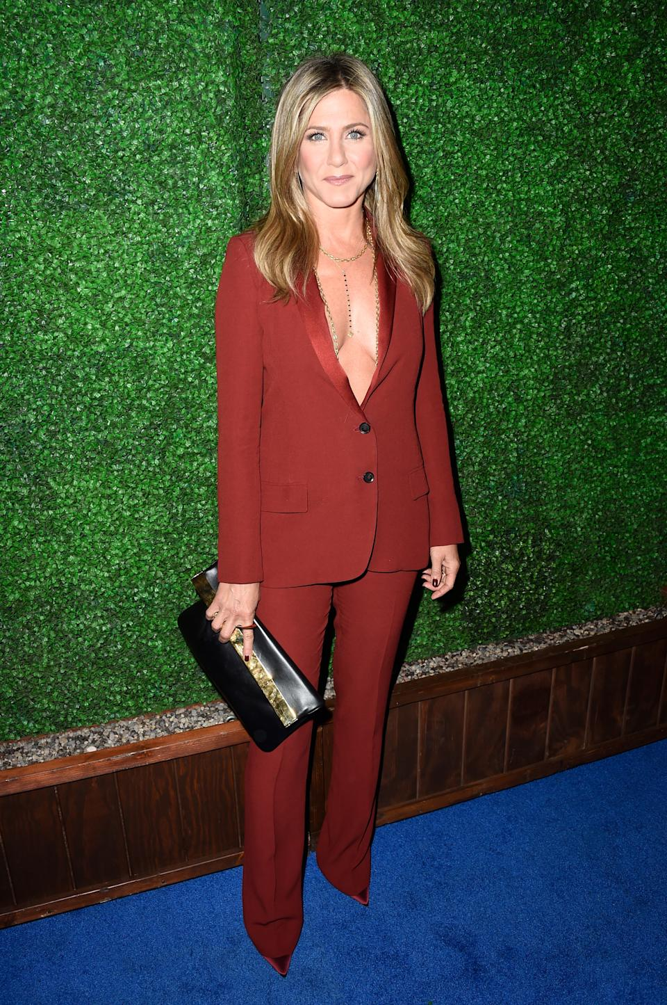 This burnt red Gucci suit with layers of gold necklaces was a hit at the 2015 Critics Choice Awards.