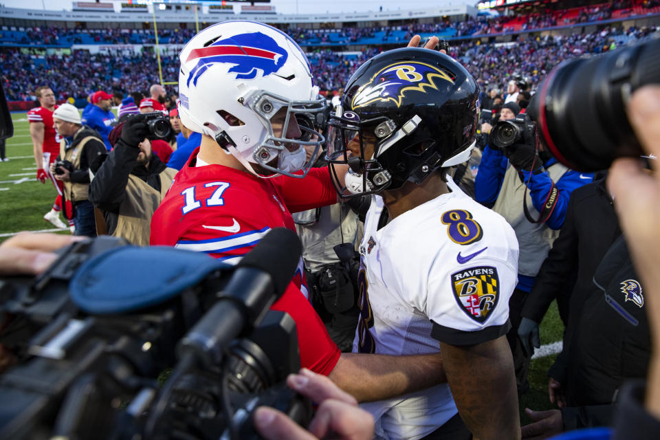 Josh Allen of the Buffalo Bills and Lamar Jackson of the Baltimore Ravens meet up in a great playoff matchup on Saturday night. (Photo by Brett Carlsen/Getty Images)