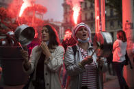 FILE - In this Friday, Oct. 2, 2020 file photo, restaurant owners clang spoons and casseroles at a demonstration against restaurant and bar closures in Marseille, southern France. The coronavirus pandemic is gathering strength again in Europe and, with winter coming, its restaurant industry is struggling. The spring lockdowns were already devastating for many, and now a new set restrictions is dealing a second blow. Some governments have ordered restaurants closed; others have imposed restrictions curtailing how they operate. (AP Photo/Daniel Cole, File)