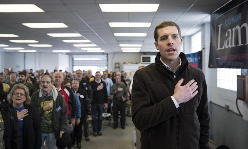 Conor Lamb recites the pledge of allegiance during a campaign rally with United Mine Workers of America at the Greene county fairgrounds Sunday in Waynesburg, Pennsylvania.