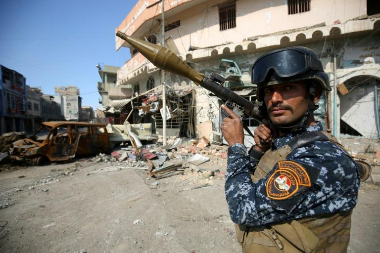 A member of the Iraqi forces stands guard at the frontline of the Old City of Mosul on March 25, 2017