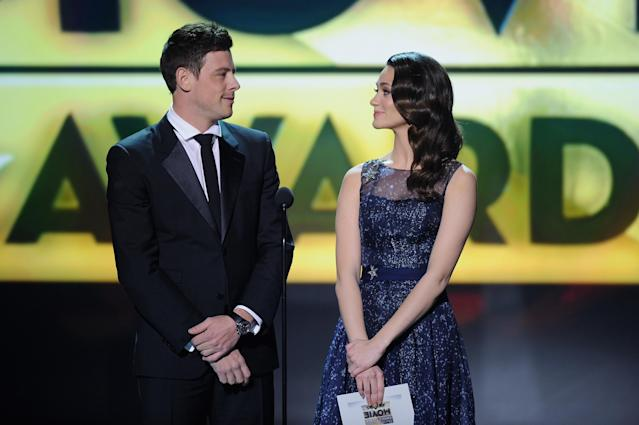 SANTA MONICA, CA - JANUARY 10: Presenters Cory Monteith (L) and Emmy Rossum speak onstage at the 18th Annual Critics' Choice Movie Awards held at Barker Hangar on January 10, 2013 in Santa Monica, California. (Photo by Kevin Winter/Getty Images)