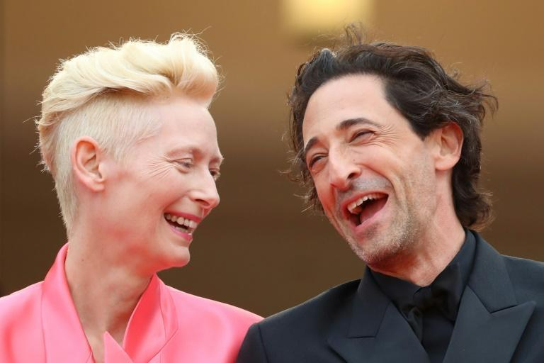Best in show: British actress Tilda Swinton has a laugh with US star Adrien Brody at Cannes