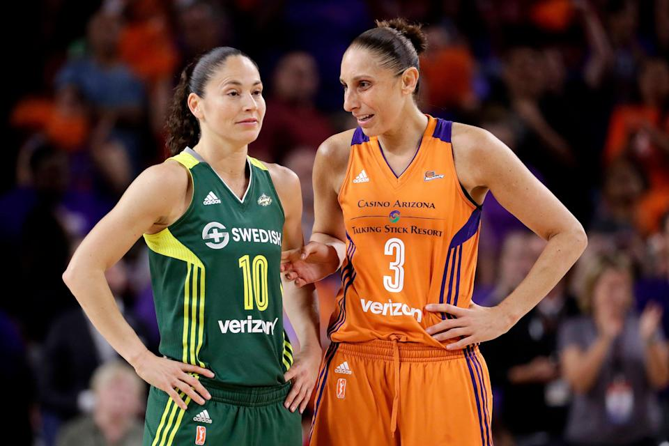 Phoenix Mercury guard Diana Taurasi (3) talks with Seattle Storm guard Sue Bird (10)  will try and become the first players ever to win five Olympic gold medals in basketball when the United States women's team begins play at the Tokyo Games.
