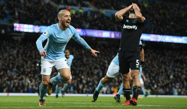Manchester City's David Silva (L) has been left out of City's squad for their game at Shakhtar Donetsk due to an unspecified injury