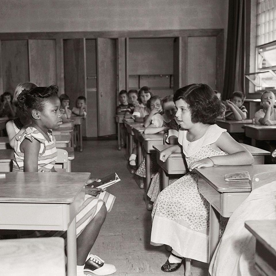 <p>The landmark Supreme Court case <em>Brown vs. the Board of Education </em>ruled that the racial segregation of students in public schools was unconstitutional. Here, students interact on their first day of learning in a desegregated classroom. </p>