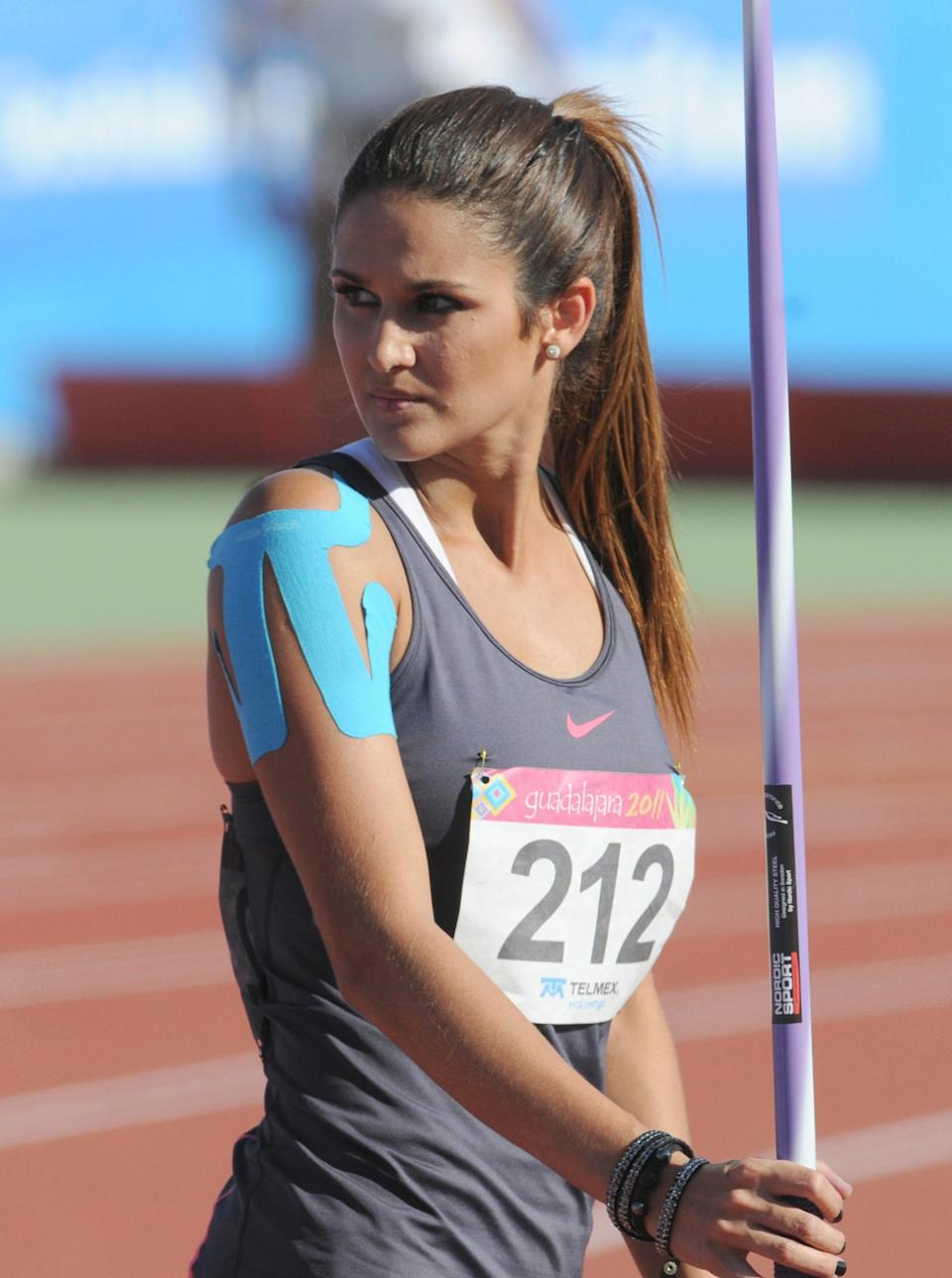 """Paraguay's Leryn Franco looks at her coach during the Javelin Throw competition, at the 2011 Pan-American Games, held at the track of """"Estadio Telmex"""" on October 27, 2011 in Guadalajara, Mexico. Franco was thirteenth with a 48.70m performance. (Photo by Eduardo G Biscayart/LatinContent/Getty Images)"""