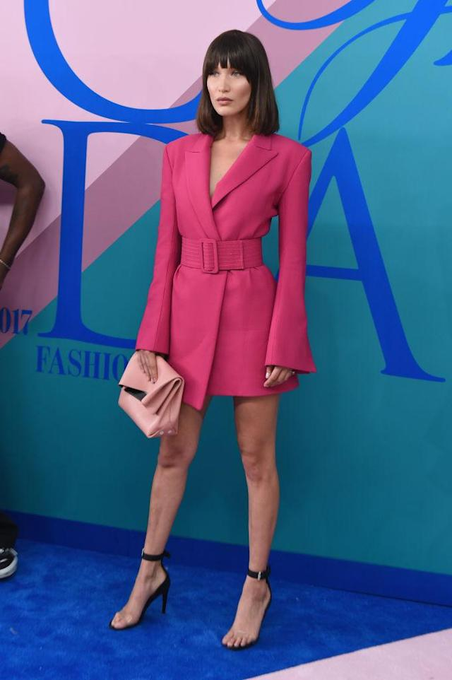 <p>Where her sister went for full coverage, Bella opted for pink and leggy. (Photo: Getty Images) </p>