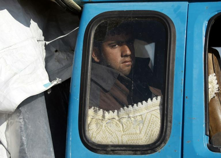 A displaced Syrian man waits inside a truck carrying his family's belongings at a checkpoint near the town of Manbij, northern Syria on March 6, 2017