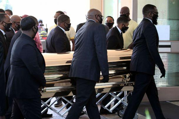 PHOTO: Men carry the coffin of George Floyd at The Fountain of Praise church in Houston, June 8, 2020. (Goran Tomasevic/Reuters)