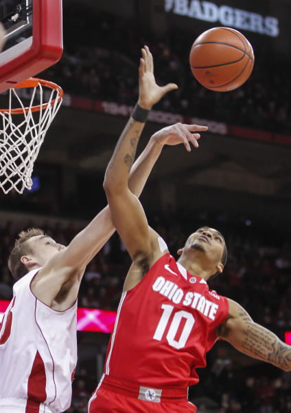 Wisconsin's Sam Dekker, left, knocks the ball away from Ohion State's LaQuinton Ross during the first half of an NCAA college basketball game Saturday, Feb. 1, 2014, in Madison, Wis. (AP Photo/Andy Manis)