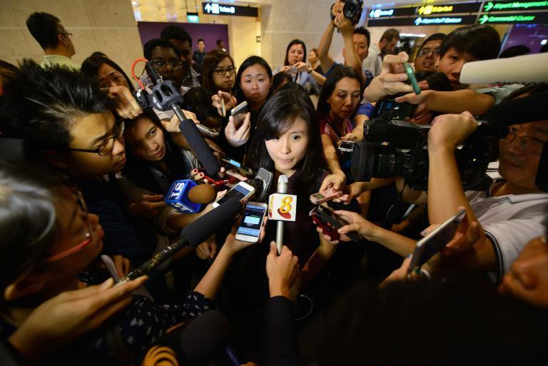 A relative of a passenger travelling on the missing AirAsia Flight QZ8501 is interviewed by the media at Terminal 1 of Singapore's Changi Airport, on December 28, 2014