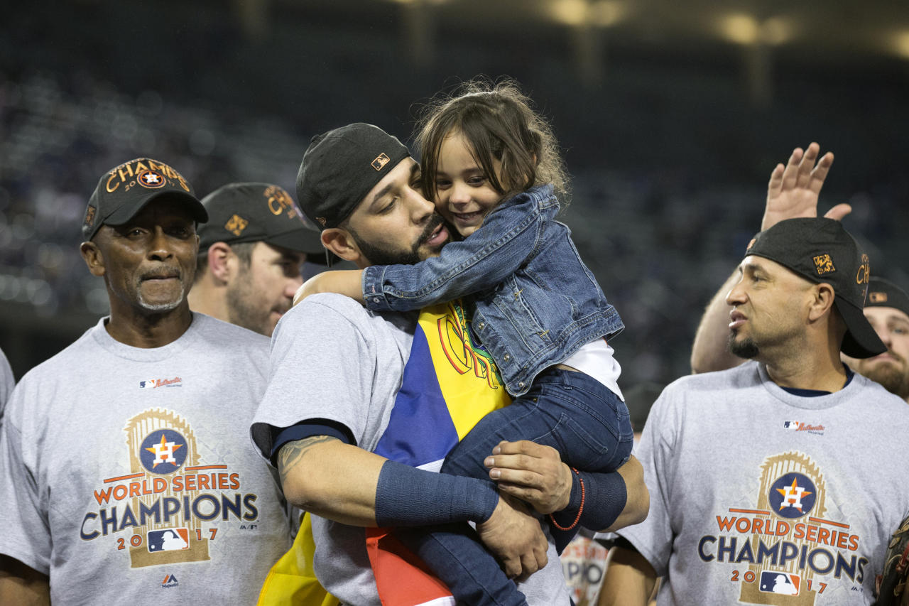 <p>Marwin Gonzalez #9 of the Houston Astros celebrates on the field with his daughter after the Astros defeated the Los Angeles Dodgers in Game 7 of the 2017 World Series at Dodger Stadium on Wednesday, November 1, 2017 in Los Angeles, California. (Photo by Rob Tringali/MLB Photos via Getty Images) </p>