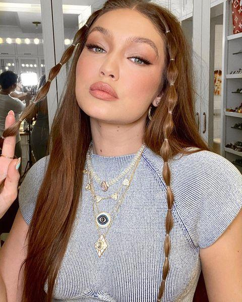 """<p>Hadid gave plaits a new twist (sorry not sorry) for her 26th birthday by bubble braiding the two front strands of her recently <a href=""""https://www.elle.com/uk/beauty/hair/g33346168/copper-hair/"""" rel=""""nofollow noopener"""" target=""""_blank"""" data-ylk=""""slk:copper"""" class=""""link rapid-noclick-resp"""">copper</a>-toned hair. We're not sure the model's hair could be any more on trend right now.</p>"""