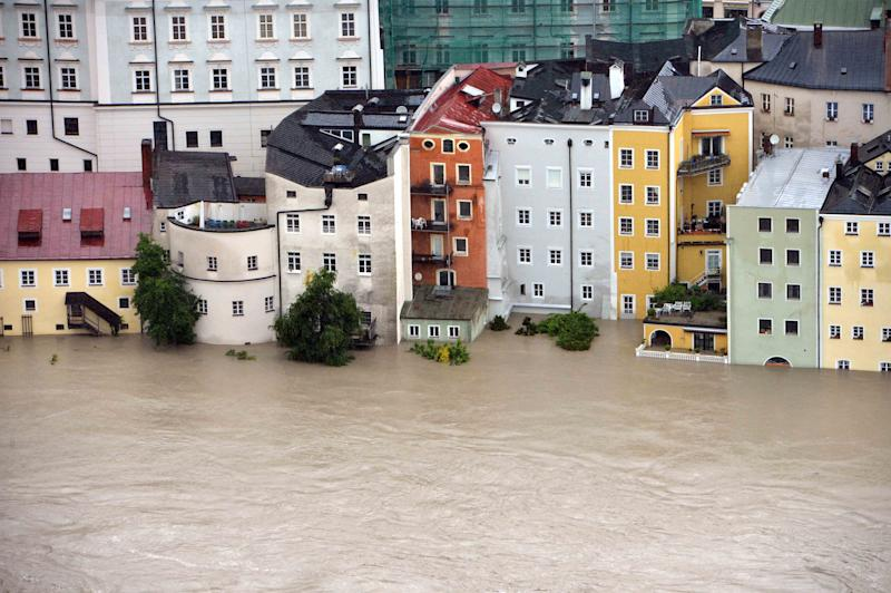 An aerial view of the flooding in Passau, Germany, photographed Monday June 3, 2013. Heavy rainfalls caused flooding along rivers and lakes in Germany, Austria, Switzerland and the Czech Republic. (AP Photo/dpa, Peter Kneffel)