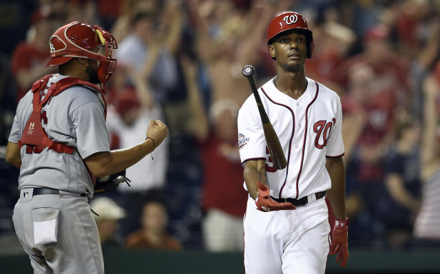 FILE - In this Sept. 5, 2018, file photo, Washington Nationals' Michael Taylor reacts after he struck to to end the baseball game as St. Louis Cardinals catcher Francisco Pena (46) pumps his fist in Washington. Washington defeated Taylor in the first salary arbitration decision this year. Taylor will receive the team's offer of $3.25 million rather than his request of $3.5 million, Friday, Feb. 1, 2019. (AP Photo/Nick Wass, File)
