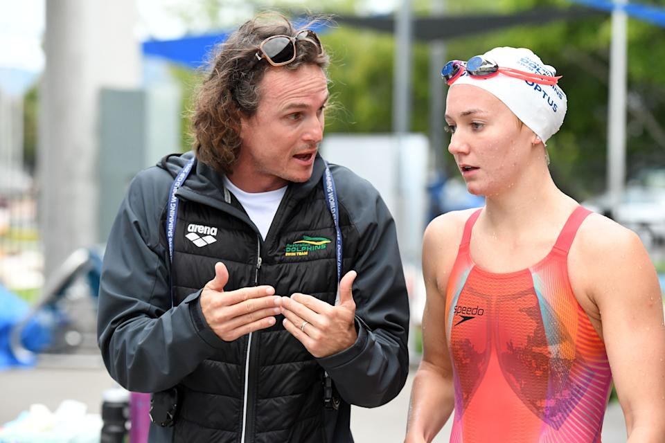CAIRNS, AUSTRALIA - JULY 20: Dean Boxall (coach) discusses strategy with Ariarne Titmus during an Australian Dolphins Swimming Team Training Camp at Tobruk Pool on July 20, 2018 in Cairns, Australia.  (Photo by Delly Carr/Getty Images)