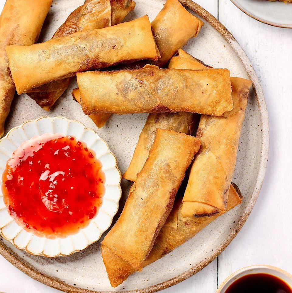 """<p>Spring rolls are a must for any <a href=""""https://www.delish.com/uk/cooking/recipes/g32460371/chinese-recipes/"""" rel=""""nofollow noopener"""" target=""""_blank"""" data-ylk=""""slk:Chinese"""" class=""""link rapid-noclick-resp"""">Chinese</a>-inspired feast. These veggie crispy <a href=""""https://www.delish.com/uk/cooking/recipes/a30559779/egg-roll-bowls-recipe/"""" rel=""""nofollow noopener"""" target=""""_blank"""" data-ylk=""""slk:spring rolls"""" class=""""link rapid-noclick-resp"""">spring rolls</a> are packed with crunchy colourful veg, ready in just under an hour. Great snack food to please the masses!</p><p>Get the <a href=""""https://www.delish.com/uk/cooking/recipes/a37067313/spring-rolls/"""" rel=""""nofollow noopener"""" target=""""_blank"""" data-ylk=""""slk:Spring Rolls"""" class=""""link rapid-noclick-resp"""">Spring Rolls</a> recipe.</p>"""