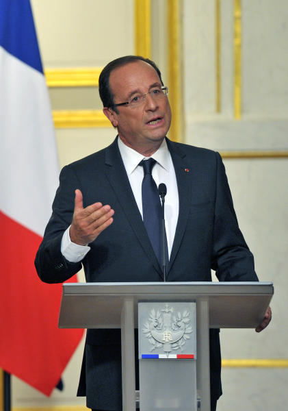 French President Francois Hollande addresses reporters during a joint press conference with Benin and African Union President Thomas Boni Yayi, unseen, at the Elysee Palace in Paris, Tuesday May 29, 2012. Francois Hollande says Syria's ambassador is being expelled amid continuing violence by Syrian government forces against civilians and opposition members. (AP Photo/Jacques Brinon)