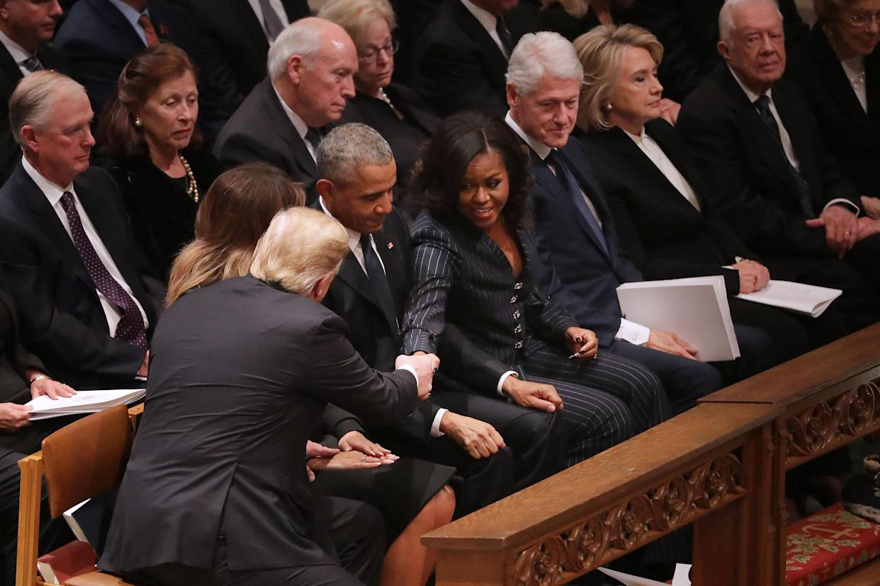 President Trump and first lady Melania Trump greet former President Barack Obama and Michelle Obama as they join other former presidents and vice presidents and their spouses for the state funeral for former President George H.W. Bush at the Washington National Cathedral on Wednesday. (Photo by Chip Somodevilla/Getty Images)