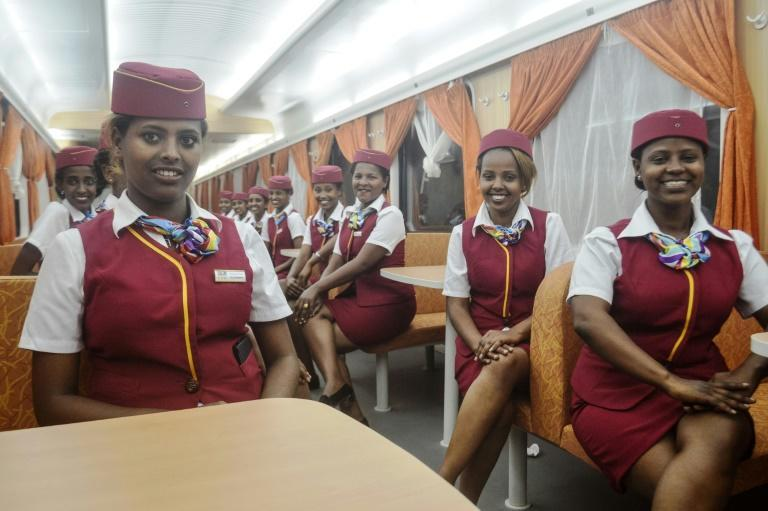 Stewardesses aboard a train on Addis Ababa-Djibouti railway, one of the major infrastructure projects which Ethiopia borrowed heavily to fund