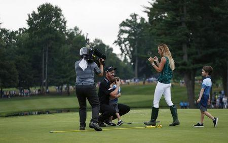 Jul 31, 2016; Springfield, NJ, USA; PGA golfer Jimmy Walker celebrates with his family on the 18th hole after winning the 2016 PGA Championship golf tournament at Baltusrol GC - Lower Course. Brian Spurlock-USA TODAY Sports