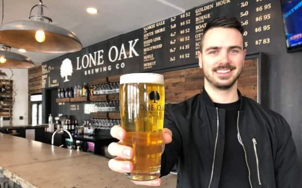 'We know that we have to be prepared,' when the bubble reopens, says Jared Murphy, co-owner of Lone Oak Brewing in Borden-Carleton. (Brian Higgins/CBC - image credit)
