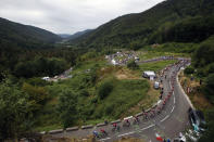 The pack rides during the sixth stage of the Tour de France cycling race over 160 kilometers (100 miles) with start in Mulhouse and finish in La Planche des Belles Filles, France, Thursday, July 11, 2019. (AP Photo/Christophe Ena)