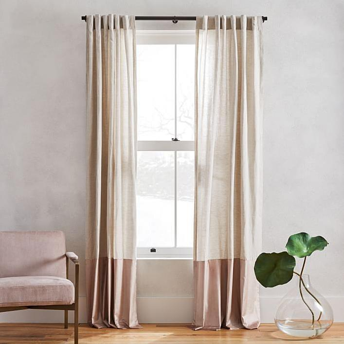"""<p>Looking for luxurious curtains that have the feel of linen with the look of thick, shiny velvet? You've found them in this tonal set, <a href=""""https://www.marthastewart.com/1513103/curtains-textiles"""" rel=""""nofollow noopener"""" target=""""_blank"""" data-ylk=""""slk:which blocks out most light"""" class=""""link rapid-noclick-resp"""">which blocks out most light</a>.</p> <p><strong><em>Shop Now:</em> </strong><em>West Elm Belgian Flax Linen Luster Velvet Curtain, $79.20, <a href=""""http://westelm.7eer.net/c/249354/267856/4336?subId1=MSL%2CTheBestSimpleLinenCurtainsforYourNeutralHome%2Cdlarson%2CCur%2CGal%2C7838948%2C202006%2CI&u=https%3A%2F%2Fwww.westelm.com%2Fproducts%2Fbelgian-flax-linen-luster-velvet-curtain-dusty-blush-t5236%2F"""" rel=""""nofollow noopener"""" target=""""_blank"""" data-ylk=""""slk:westelm.com"""" class=""""link rapid-noclick-resp"""">westelm.com</a></em><em>. </em></p>"""