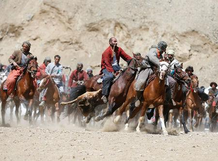 Afghan horsemen compete during a Buzkashi game in Panjshir province, north of Kabul, Afghanistan