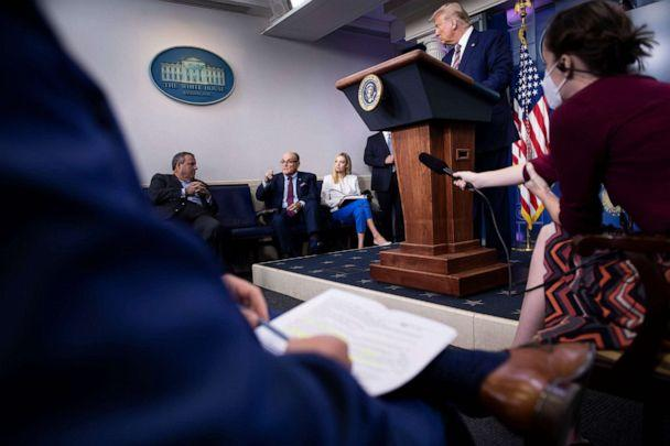 PHOTO: US President Donald Trump, and others listen while former New York City Mayor Rudy Giuliani speaks during a briefing at the White House September 27, 2020, in Washington, DC. (Brendan Smialowski/AFP via Getty Images)