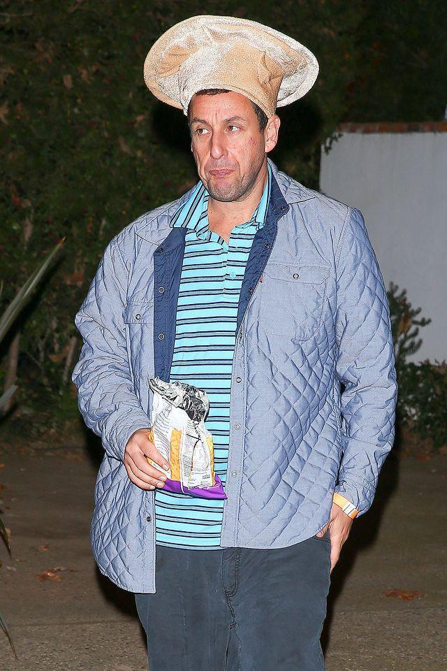 <p>Sandler put as little effort as possible into his costume by wearing a velvet pizza hat. Couldn't he have at least thrown on a red shirt? (Photo: AKM-GSI) </p>