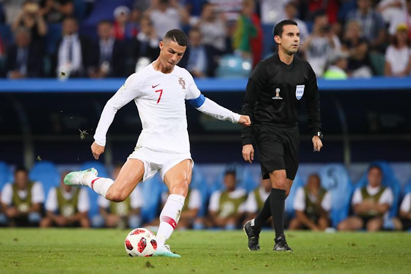 SOCHI, RUSSIA - JUNE 30: Cristiano Ronaldo of Portugal takes a free kick during the 2018 FIFA World Cup Russia Round of 16 match between Uruguay and Portugal at Fisht Stadium on June 30, 2018 in Sochi, Russia. (Photo by Matthew Ashton - AMA/Getty Images)