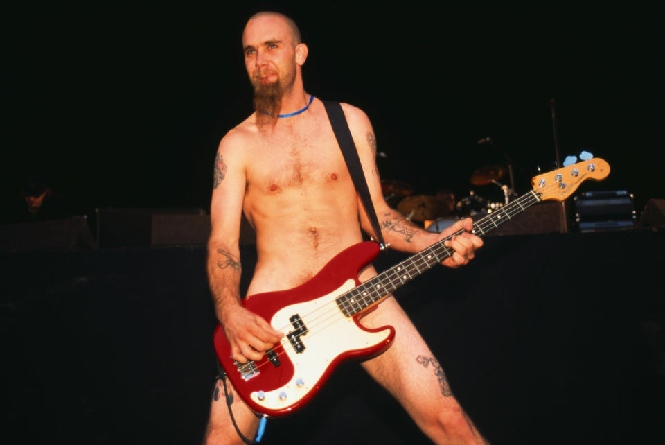 RIO DE JANEIRO, BRAZIL - JANUARY 19: Nick Oliveri from Queens Of The Stone Age performs in the nude at Rock In Rio Festival in Rio De Janeiro, Brazil on January 19 2001 (Photo by Mick Hutson/Redferns)