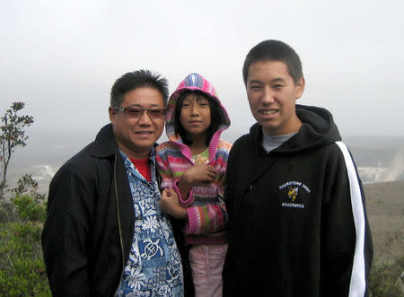 Kenneth Bae, with his daughter Natalie, and son Jonathan, is pictured in this undated family handout photo