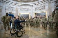Rep. Brian Mast, R-Fla., left, visits with National Guard troops who are helping with security at the Capitol Rotunda in Washington, Wednesday, Jan. 13, 2021. (AP Photo/J. Scott Applewhite)