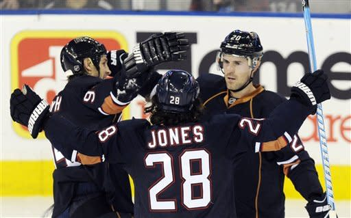 Edmonton Oilers' Ryan Jones (28) and Ryan Smyth, left, congratulate Eric Belanger on his goal against the Colorado Avalanche during the first period of an NHL hockey game, Tuesday, Jan. 31, 2012, in Edmonton, Alberta. (AP Photo/The Canadian Press, John Ulan)