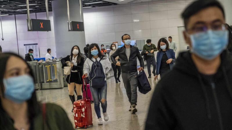 Travelers wear face masks at the West Kowloon train station in Hong Kong on Wednesday, Jan. 22, 2020. The mysterious new pneumonia-like coronavirus has turned the Lunar New Year holiday in China - the world's largest annual migration of people - into an epidemiologist/s nightmare. (Lam Yik Fei/The New York Times)