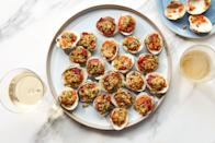 "A vinegary red bell pepper mixture cuts through the richness of this classic Italian-American appetizer. Roast just before serving so they're hot and crispy. <a href=""https://www.epicurious.com/recipes/food/views/clams-casino-with-bacon-and-bell-pepper?mbid=synd_yahoo_rss"" rel=""nofollow noopener"" target=""_blank"" data-ylk=""slk:See recipe."" class=""link rapid-noclick-resp"">See recipe.</a>"