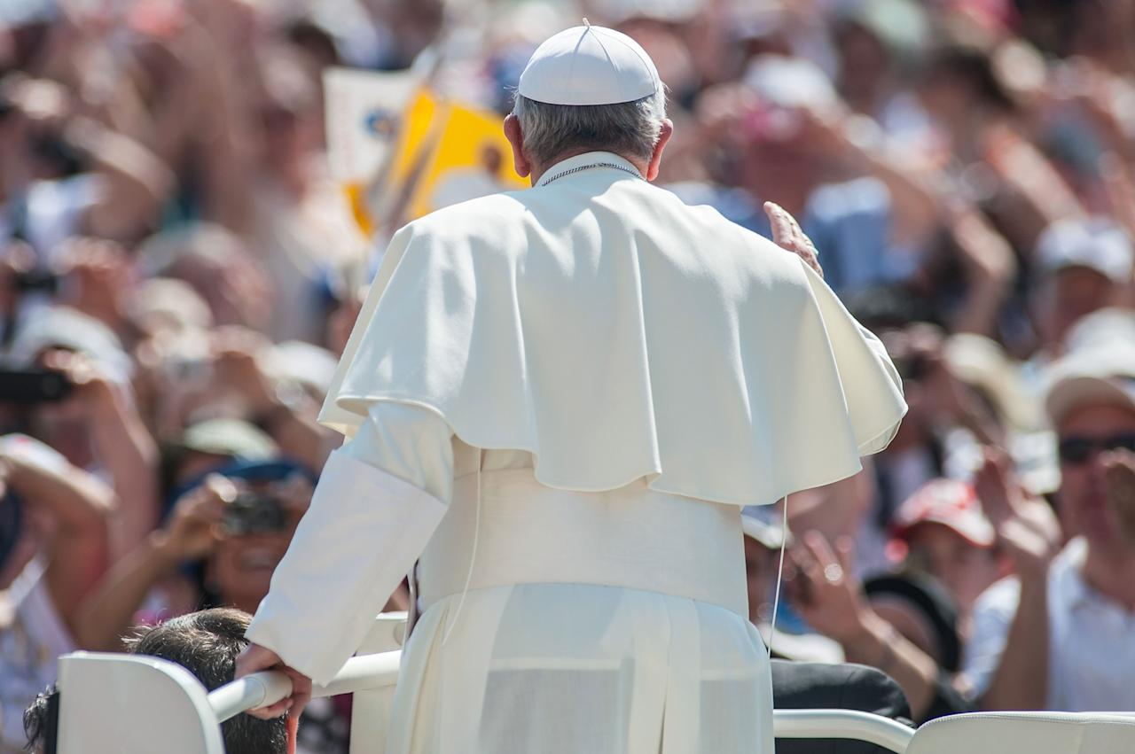 VATICAN CITY, VATICAN - JUNE 16: Pope Francis waves to the faithful as he arrives on popemobile to celebrate the mass for 'Evangelium Vitae' Day at at St. Peter's Square on June 16, 2013 in Vatican City, Vatican. (Photo by Giorgio Cosulich/Getty Images)