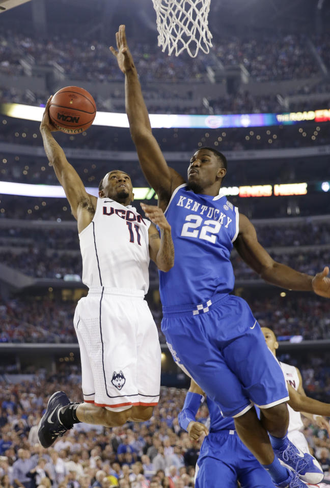 Connecticut guard Ryan Boatright, left, drives to the basket past Kentucky forward Alex Poythress during the first half of the NCAA Final Four tournament college basketball championship game Monday, April 7, 2014, in Arlington, Texas. (AP Photo/David J. Phillip)